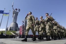 Ukrainian soldiers march in front of the Motherland Monument in Kiev [Anatolii Stepanov/AFP/Getty Images]