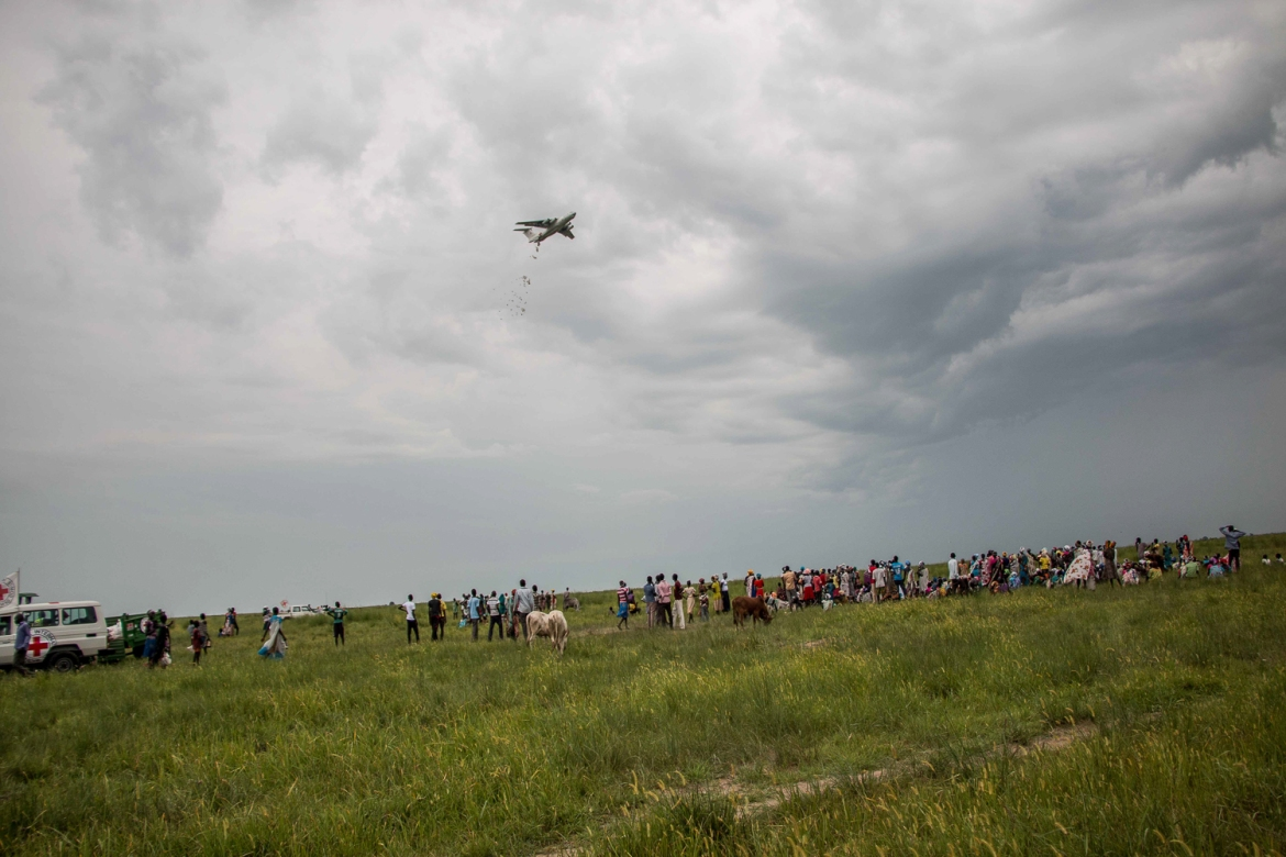 Food is being air-dropped to feed 7,500 households – at least 37,000 people – during the two week distribution in Waat. [Ashley Hamer/Al Jazeera]
