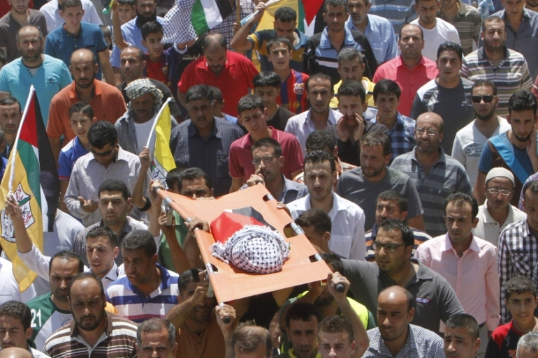 Mourners carry the body of 18-month-old Palestinian baby Ali Dawabsheh [Reuters]