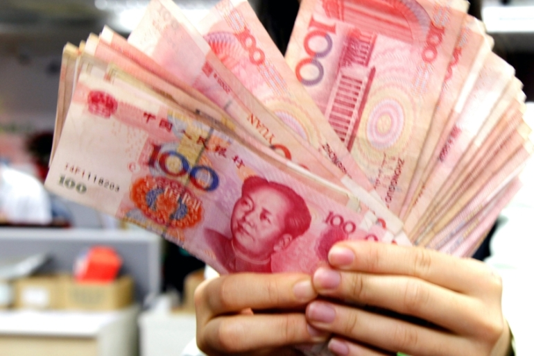 China is preparing to launch a digital version of its currency, the yuan, and says it wants to strike a balance between anonymity and its ability to control money laundering activities [File: EPA]