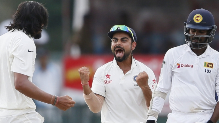 India''s Sharma celebrates with captain Kohli after taking the wicket of Sri Lanka''s Tharanga during the fourth day of their third and final test cricket match in Colombo