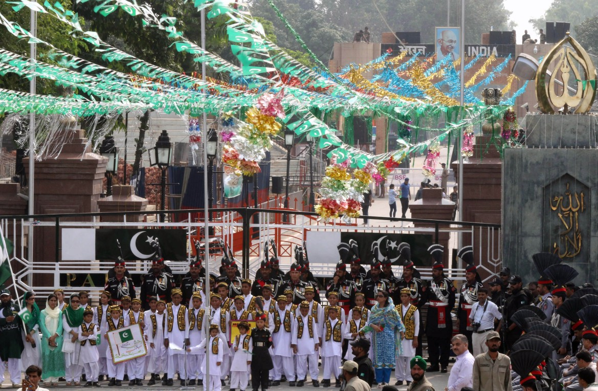 Pakistani people attend a ceremony marking the day it got freedom from Britain. [Rahat Dar/EPA]