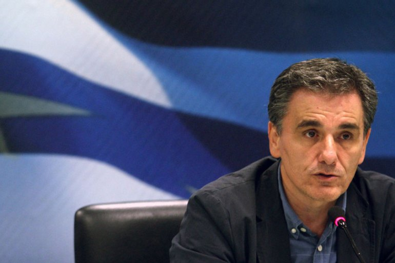 Finance Minister Euclid Tsakalotos said 'two or three details remain' after all-night negotiations with international lenders [EPA]