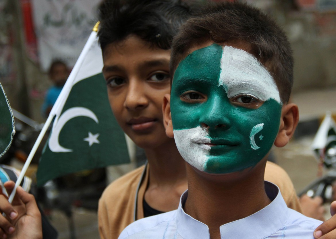 Young Pakistanis celebrate Independence Day in Hyderabad, Pakistan. [Nadeem Khawe/EPA]