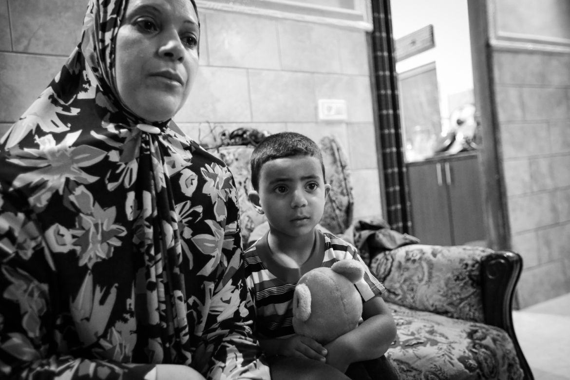 "Samar Hammad, whose 18-year-old son Mahmoud was arrested by Israeli soldiers during a night raid, said family and neighbours confronted the Israeli soldiers in the street. ""I got him a shirt and came back outside and they were beating our neighbour's boys, and they took him away and I didn't even see him or have a chance to say goodbye,"" she said. [Kelly Lynn/Al Jazeera]"