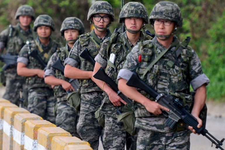 South Korean soldiers stand guard near the border village of Panmunjom where the talks are being held [AP]