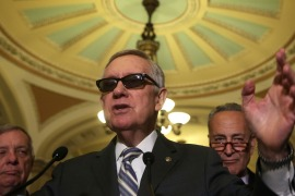 Senators Richard Durbin (D-IL) left, Harry Reid (D-NV), centre, and Charles Schumer (D-NY), right, at a news briefing in Washington following the Senate Democratic Party Luncheon on July 14.