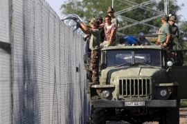 Hungary is hoping to finish erecting a 175km razor-wire fence in the next few days [Reuters]
