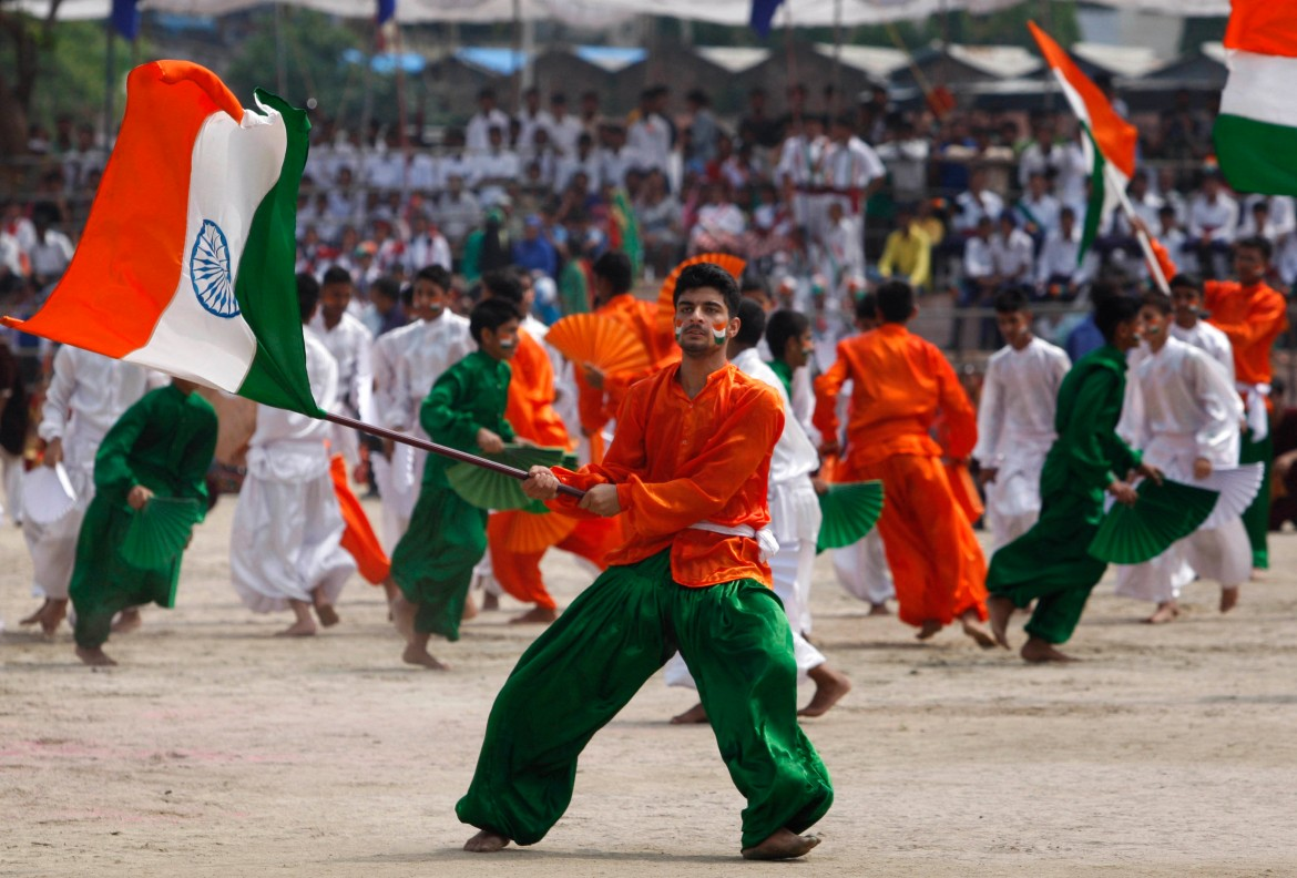 School student perform on the occasion of 69th anniversary of independence from British rule in Jammu in India administered Kashmir. [Channi Anand/AP]
