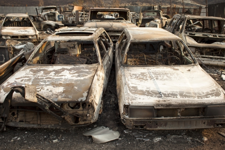 Wildfires across the drought-plagued western US states have forced residents to flee their homes [AP]