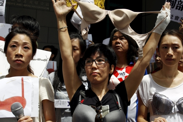 Protesters wear bras over their shirts during a demonstration in support of local female protester Ng Lai-ying [Reuters]
