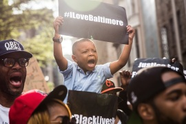 Protesters march demanding greater police accountability following the death of Freddie Gray in Baltimore, Maryland on April 30, 2015 [Andrew Burton/Getty Images]