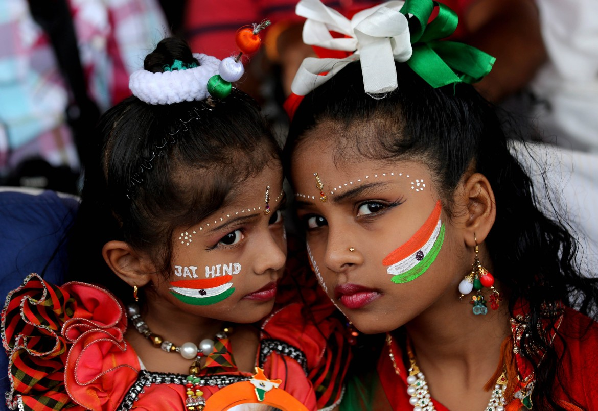 Indian girls have their faces painted with national flags during Independence Day celebrations in Bangalore. [Jagadeesh Nv/EPA]