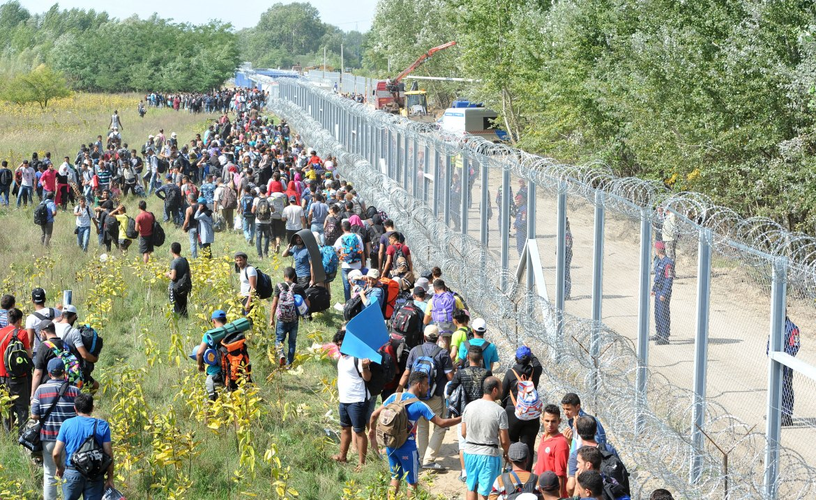Hungary has sealed the last gap in the barricade along its border with Serbia, closing passage to thousands of refugees  waiting on the other side [Darko Dozet/EPA]