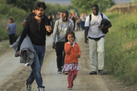 Refugees cross Croatia border in search of new route