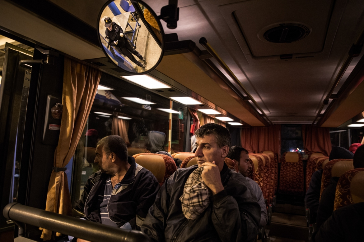 Refugees inside the bus that will take them to Opatovac. About 2,000 are still waiting along the short stretch of land between the checkpoints at the Tovarnik border crossing. [Ioana Moldovan/Al Jazeera]