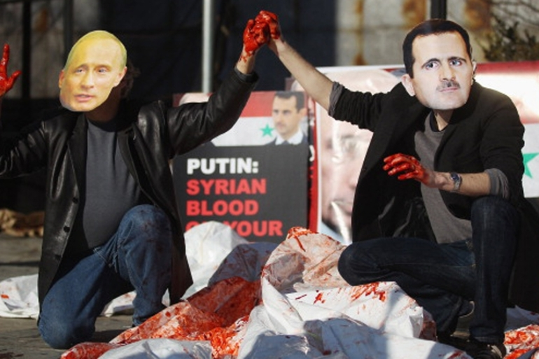 Actors wearing masks of Assad and Putin perform during a demonstration outside UN headquarters in 2011 [Getty]