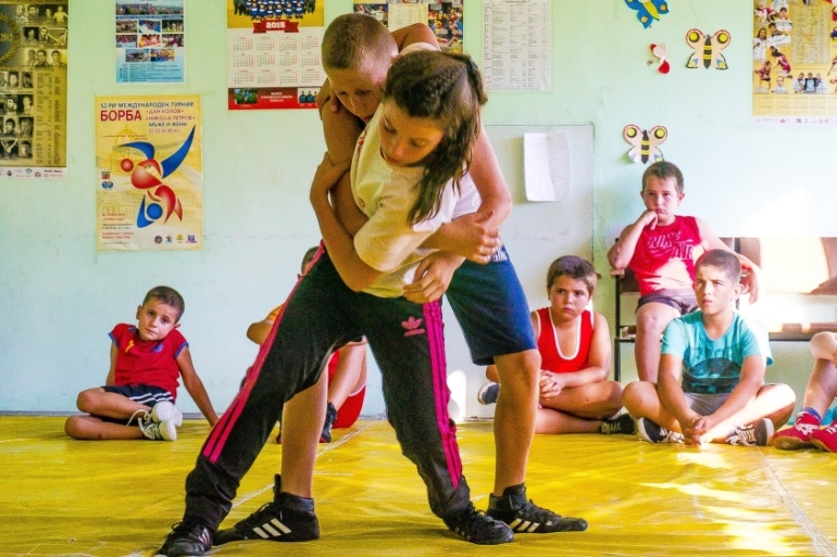 Wrestling is the only sport 11-year-old Elis has ever done and she says she loves it [Mariya Petkova/Al Jazeera]