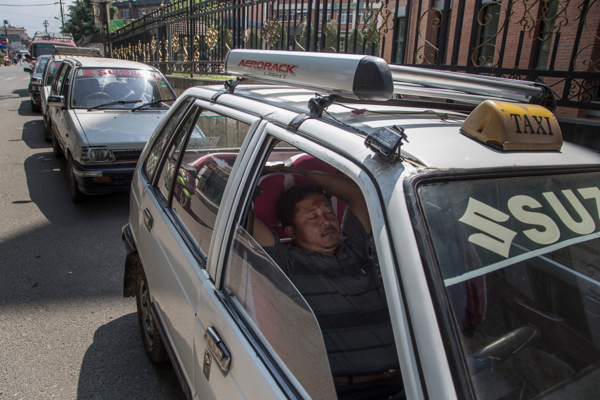 The Nepali government is only allowing people to drive on alternate days. [Omar Havana/Al Jazeera]