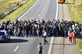Refugees tried to reach Sweden on foot along the highway at the Danish-German border, but Danish police later closed the highway [AP]