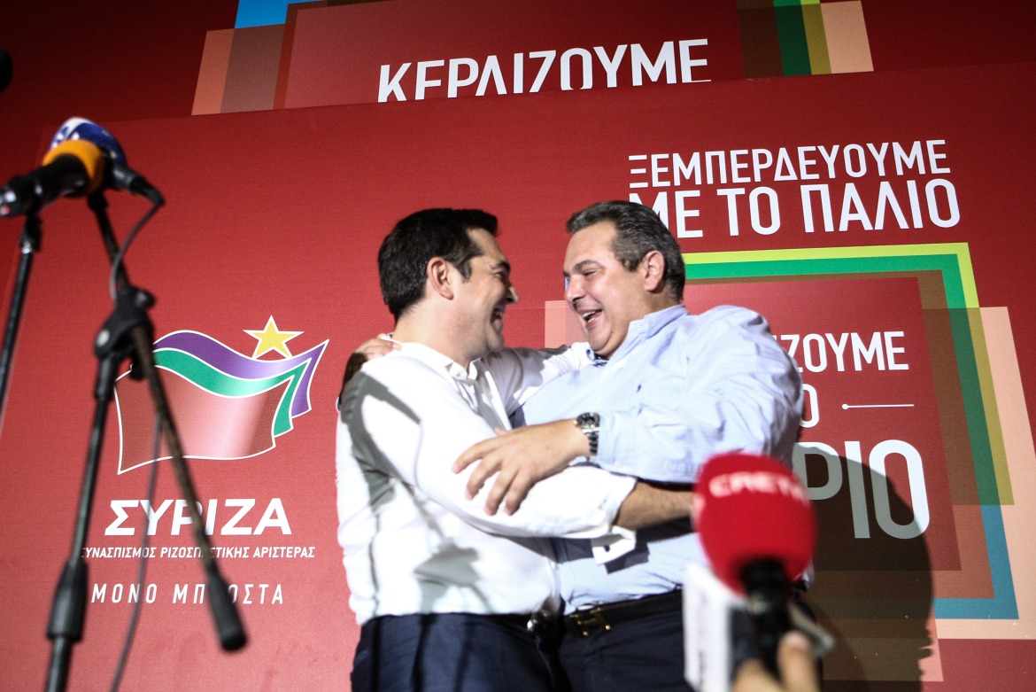 Leader of the Syriza party Alexis Tsipras and his probable future coalition government ally, Panos Kammenos of the Right Wing independent Greeks party, celebrate together the clear victory of SYRIZA as well as the Independent Greeks re-entering the parliament. The two parties have the necessary MP's to form a coalition government, as they have done in the past. [Nick Paleologos/SOOC]