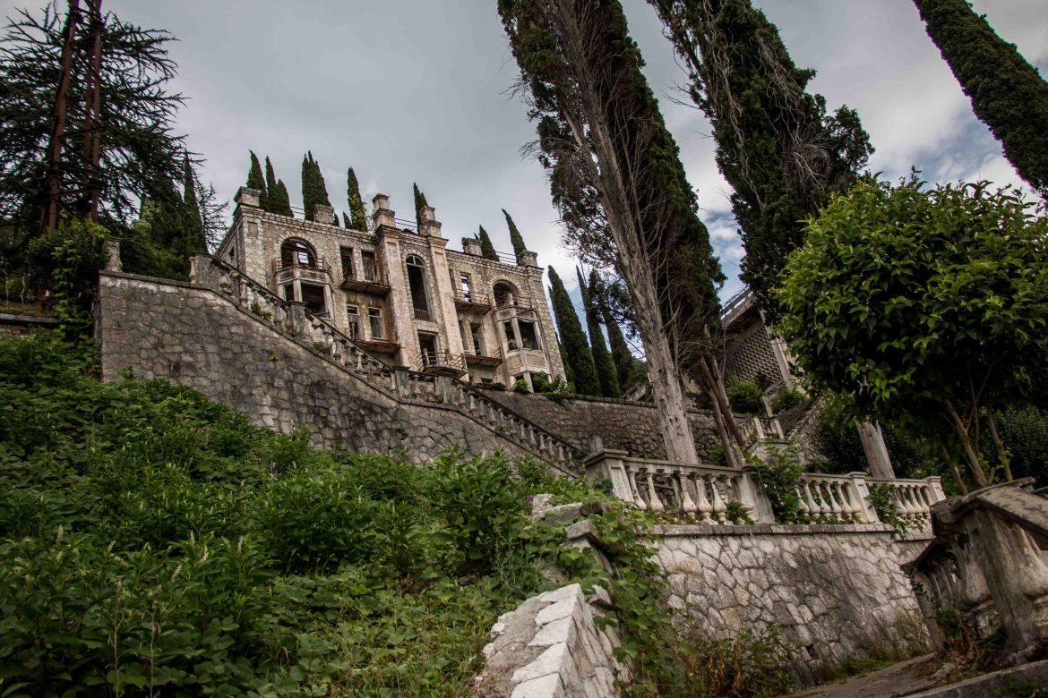For Imperial Russia and also during the Soviet Union, Gagra was a major holiday city - dubbed the 'Russian Riviera'. After the Soviet collapse and Georgian/Abkhaz war, the population shrank and many sprawling hillside mansions were damaged and abandoned. [Al Jazeera]