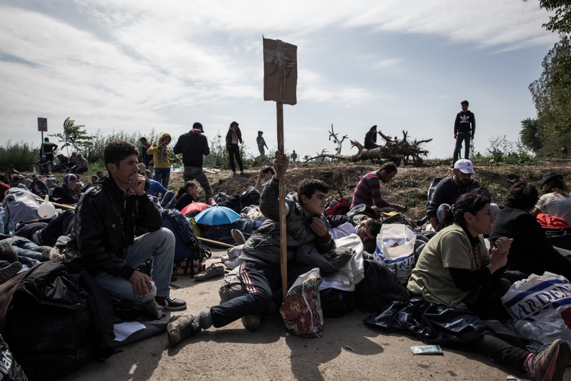 Around 2,000 refugees are waiting on the piece of land between Serbia and Croatia at the Sid-Tovarnik border crossing. They are organised into groups of 50 for easier access to buses. According to a volunteer, the idea came from a refugee. [Ioana Moldovan/Al Jazeera]