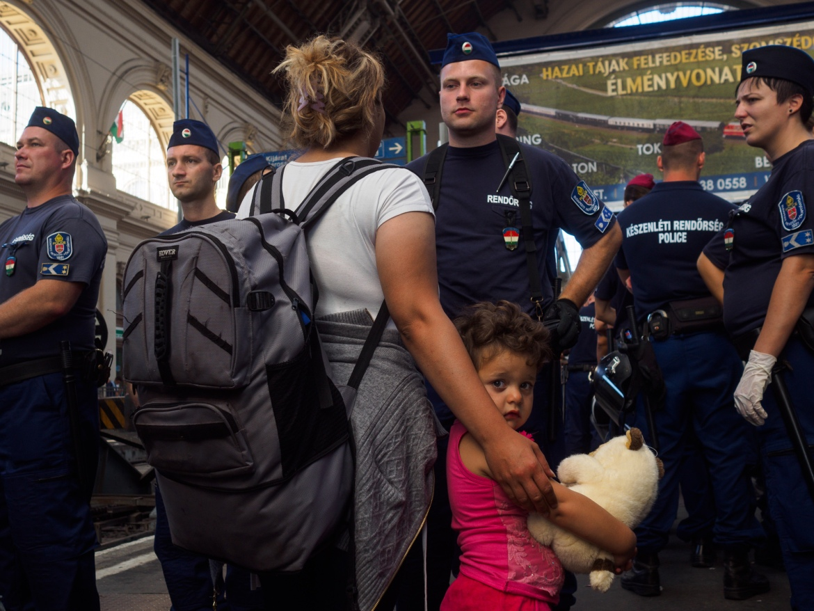 Police watched over increasingly frustrated refugees at Budapest's main train station.  [Lazar Simeonov/Al Jazeera]
