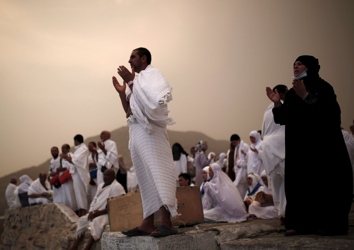 Muslim pilgrims pray on Mount Mercy on the plains of Arafat. [Ahmad Masood/Reuters]