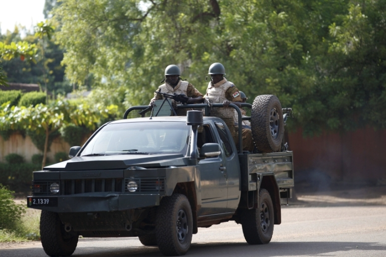 Burkina Faso's loyalist soldiers stand guard outside the foreign affairs ministry in Ouagadougou [Reuters]
