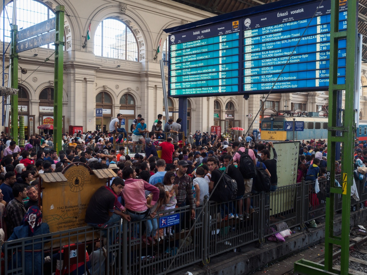 The refugees were eventually allowed inside the train station in the early hours of Tuesday morning, but, unlike local travellers and tourists, they were not allowed to take the trains bound for Germany. [Lazar Simeonov/Al Jazeera]