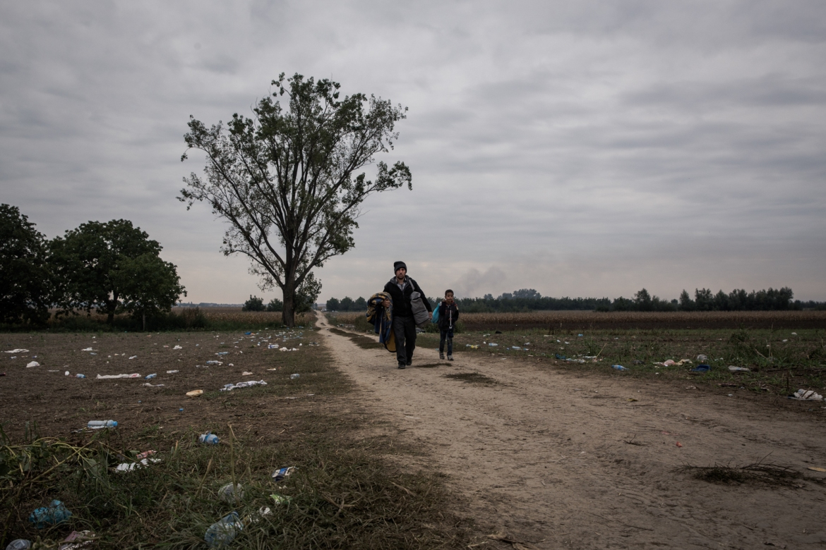 "Refugees crossing the border between Serbia and Croatia on foot. They take a path through the cornfields close to the checkpoints to get to the ""no man's land"" between the two countries. [Ioana Moldovan/Al Jazeera]"