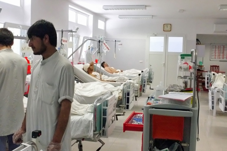 Afghan doctors treat the wounded at Emergency, the Italian-run hospital treating war victims in the capital, Kabul [Bethany Matta/Al Jazeera]