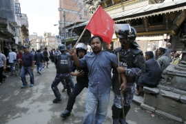 Nepal passes secular constitution amid protests