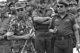 Suharto, 2nd left with sunglasses, crushed Indonesia's communist movement in a purge that killed an estimated 500,000 people [AP]
