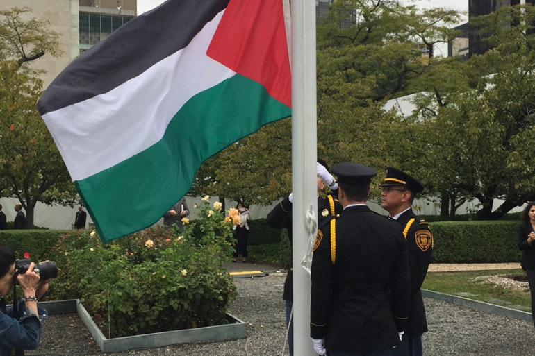 The flag was raised in the rose garden after President Abbas delivered a speech to the UN General Assembly [Brian Chacon/Al Jazeera]