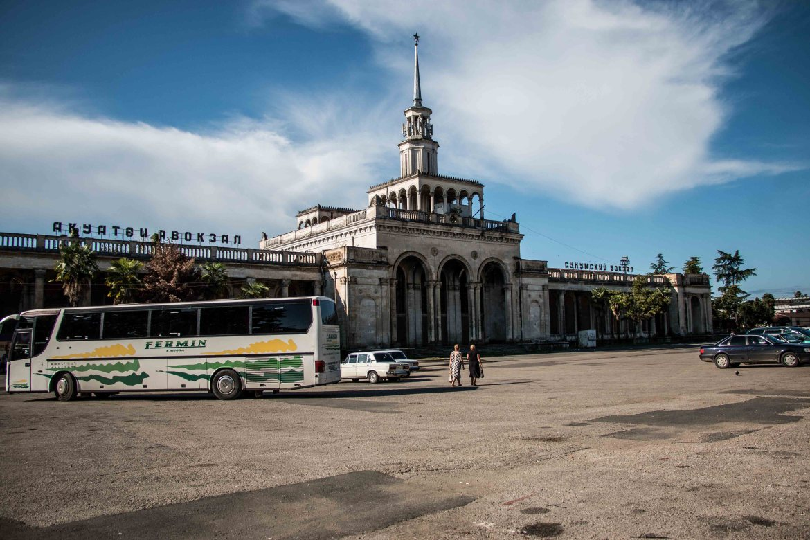 The crumbling Sukhumi train station, now serving as the province's public bus transport hub. [Al Jazeera]