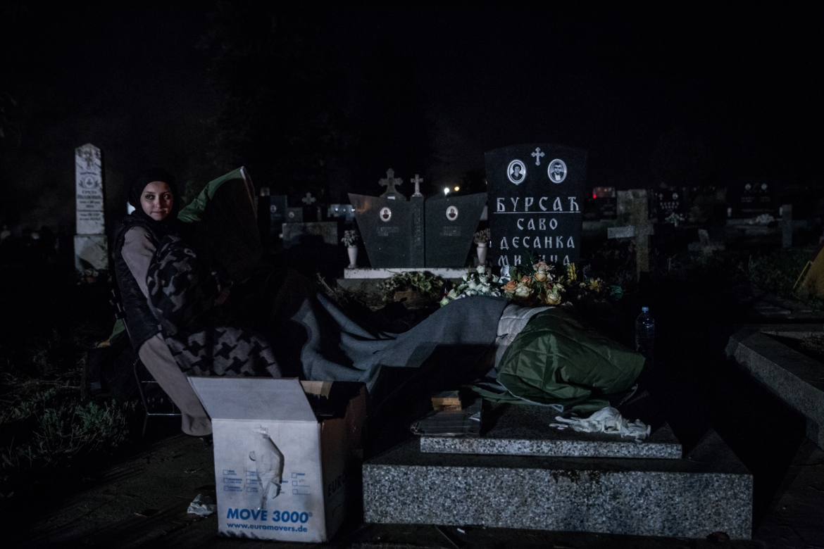 Refugees sleeping among the graves at the border crossing. They have been stuck over night at the border between the Serbian town of Sid and Tovarnik in Croatia. [Ioana Moldovan/Al Jazeera]