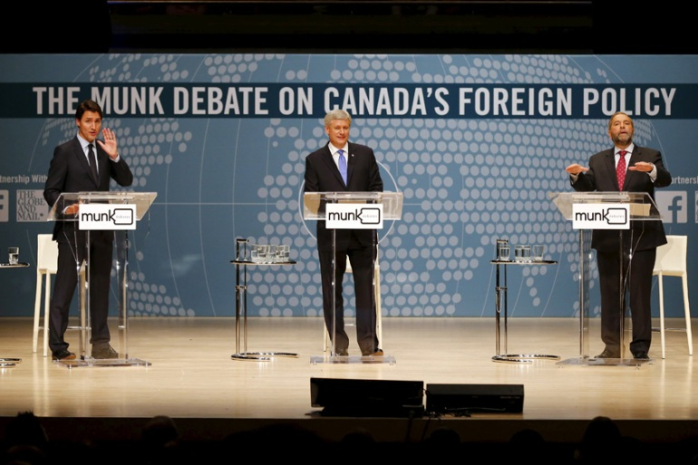 Liberal leader Justin Trudeau, left, Conservative leader Stephen Harper, and New Democratic Party chief Thomas Mulcair, right, debate foreign policy [Mark Blinch/Reuters]