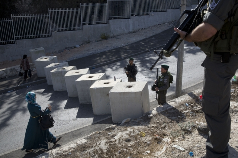 Israeli forces have set up checkpoints across occupied East Jerusalem and closed off Palestinian neighbourhoods [AP]