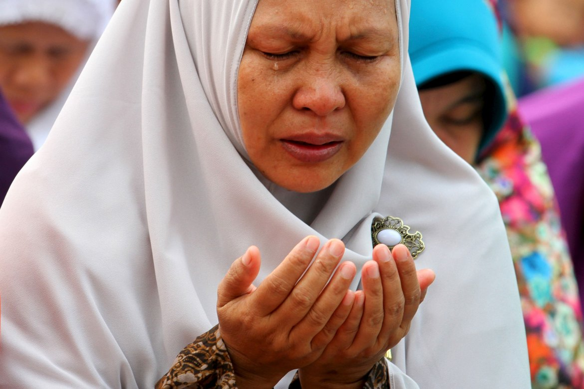 A woman cries during a mass prayer for rain in Palembang. Indonesia is hoping for rain to help extinguish the forest fires. [Nova Wahyudi/Antara Foto/Reuters]