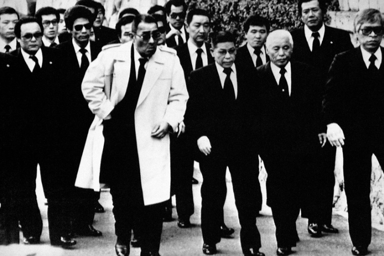 Members of the yakuza arrive for the funeral of boss Masahisa Takenaka, who was killed by a splinter group gunman in 1985 [AP]
