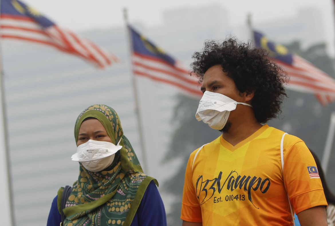 The haze is caused by the burning of forests in Indonesia's Sumatra and Borneo islands. [Joshua Paul/AP]