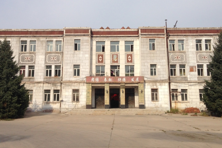 The 'derelict' Zhongtian textile factory in Qiqihar was built in 1960 with the help of the USSR [Raphael Balenieri/Al Jazeera]