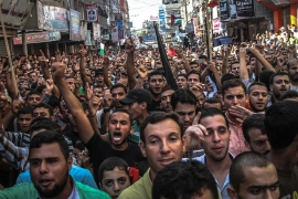 More than 1,000 Palestinians marched through the Jabalya refugee camp in Gaza during a Day of Rage on October 16 [Ezz Zanoun/Al Jazeera]