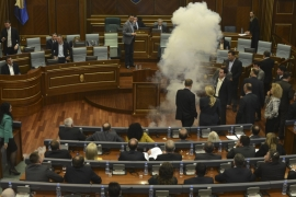 The session was immediately cancelled as smoke from the tear gas filled the chamber [EPA]