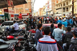 A queue at a petrol station stretches 2km in Kathmandu that some had waited in for two weeks [Ian Lloyd Neubauer/Al Jazeera]