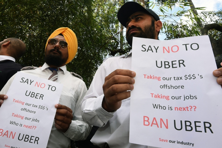 Taxi drivers in Australia have demonstrated against the Uber ride-sharing service [Dan Peled/EPA]