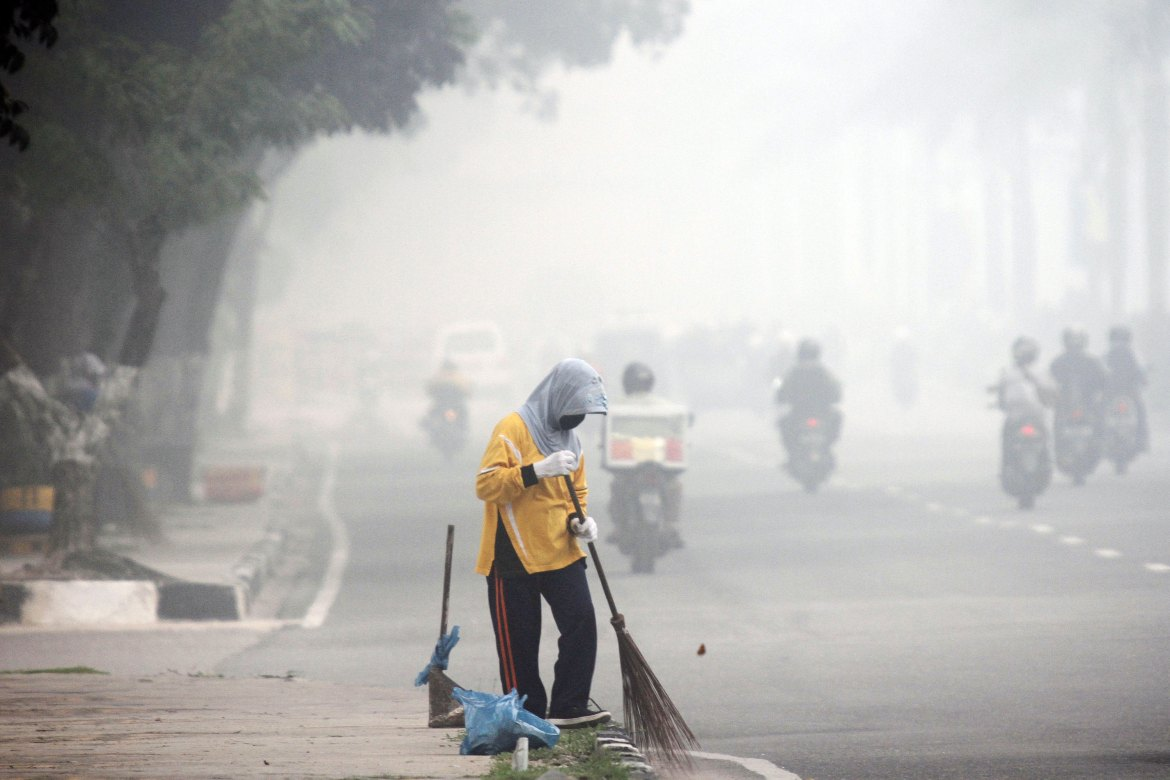 Riau's authorities said that more than 140,000 people have suffered respiratory infections because of the smog, which has covered much of Sumatra and Borneo islands for more than two months. [Rony Muharrman/EPA]