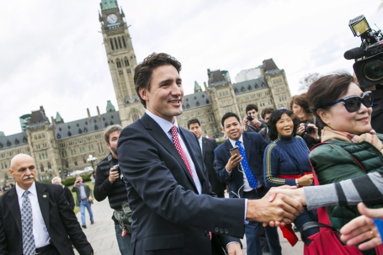Trudeau greets people as he leaves Parliament Hill for a press conference in Ottawa, Canada [EPA]
